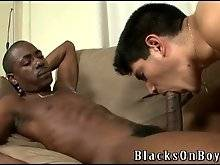 Naughty guy passionately sucks his first black dick.